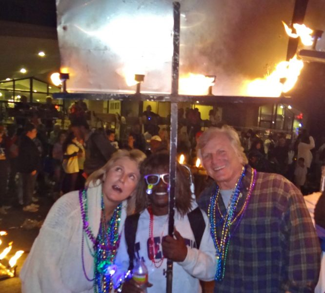 Jim and I wondering how this Flambeau carrier carried it for the 5 mile parade route.