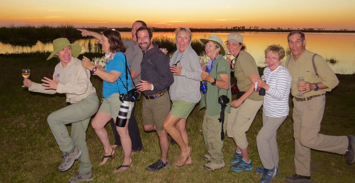 No we are not running from a man eating lion- just having fun with our friends as the orange sun set  over the Chobe River