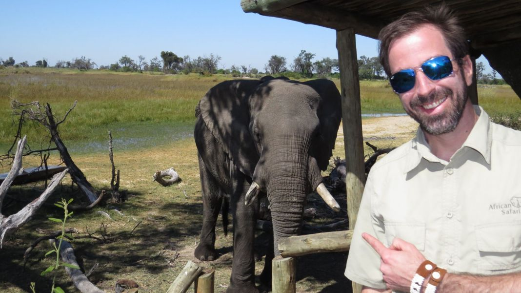 Our friend David hanging out with the old bull elephant which later that night rubbed his back on David's tent