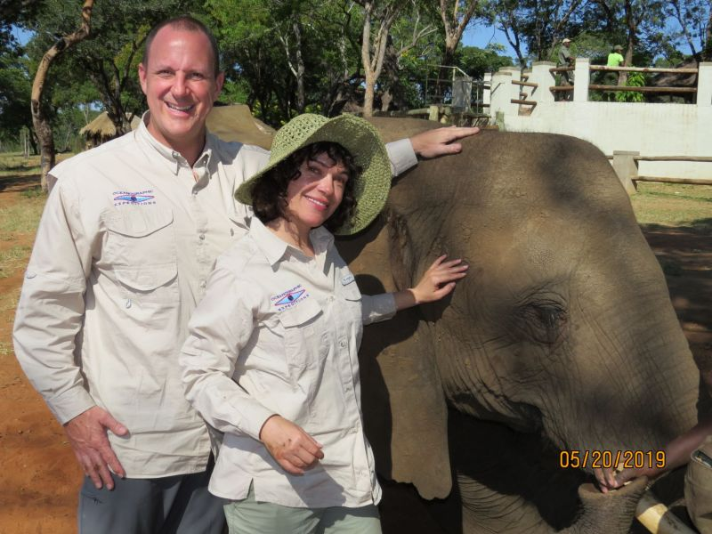Our friends ,Chris and Kim, Getting up close and personal with one of the elephants on our elephant back safari