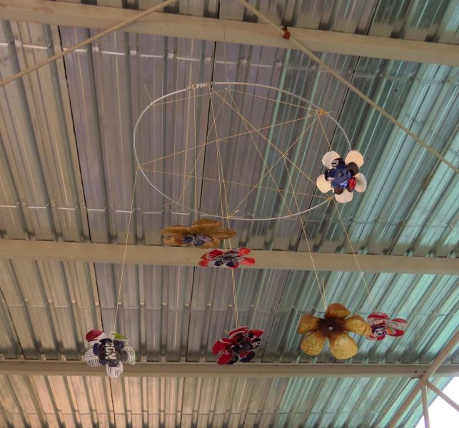 These amazing mobiles are and example of a simple craft or art these children would have never been exposed to