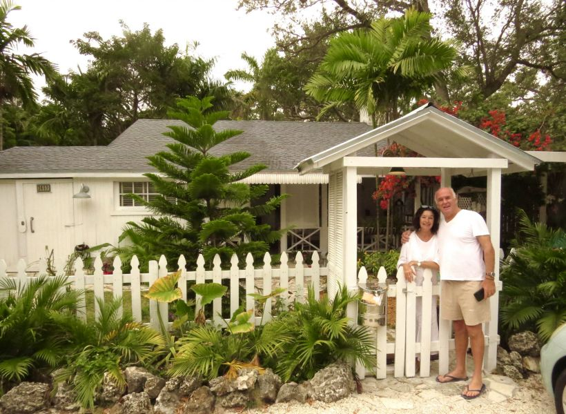 This is Phil and Suzy in front of their lovely cottage