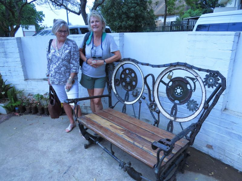 Outdoor furniture made simply from parts and pieces of  tractors, automobiles and buses